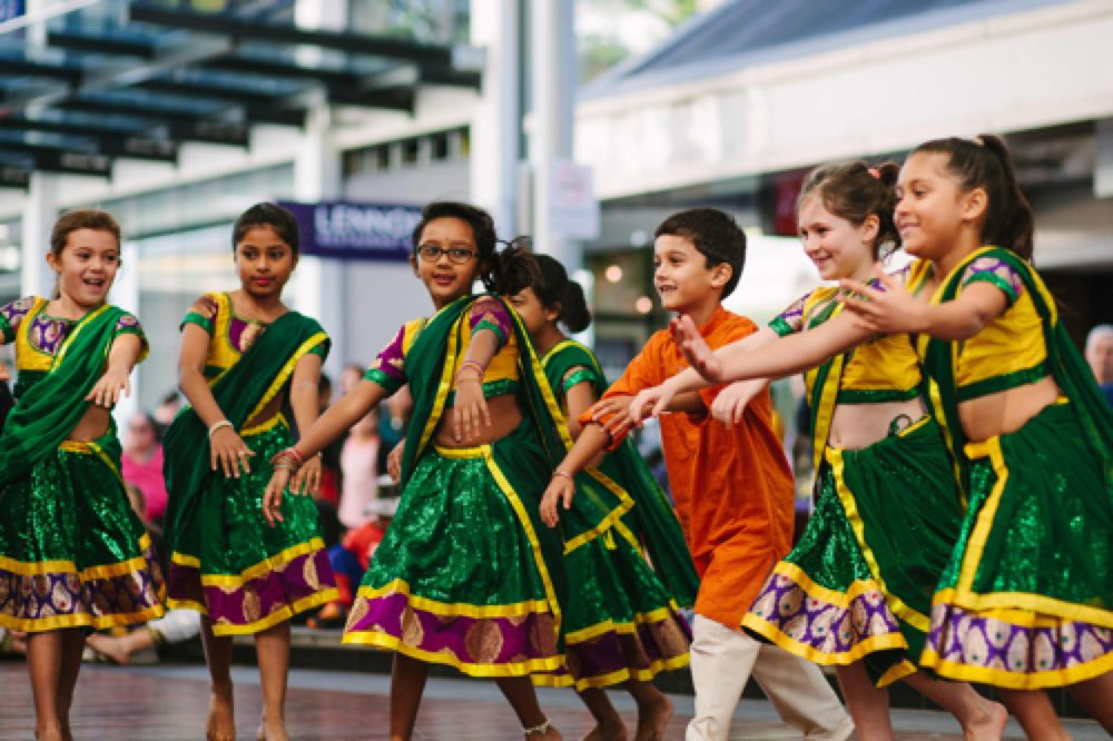 children dancing in traditional indian attire