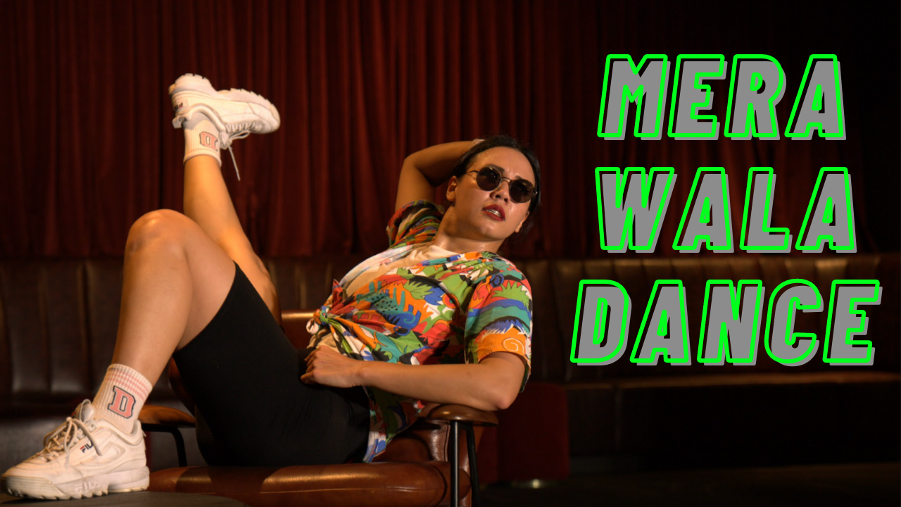 Woman pulling dance move with sunglasses on with the word Mera Wala Dance on the image